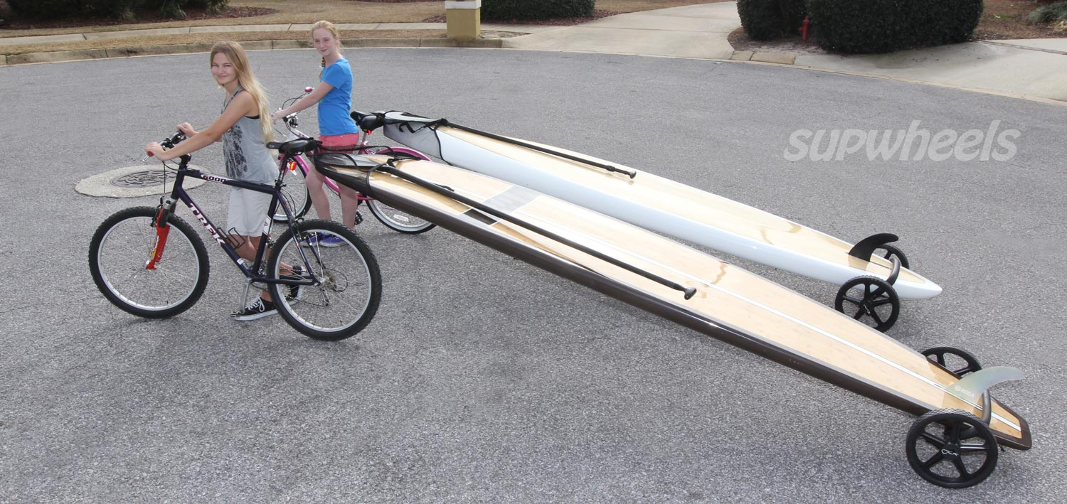 SUP Bike Trailer on road with two girls and two boards