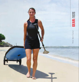 Girl walking SUP Wheels and SUP board to water at beach